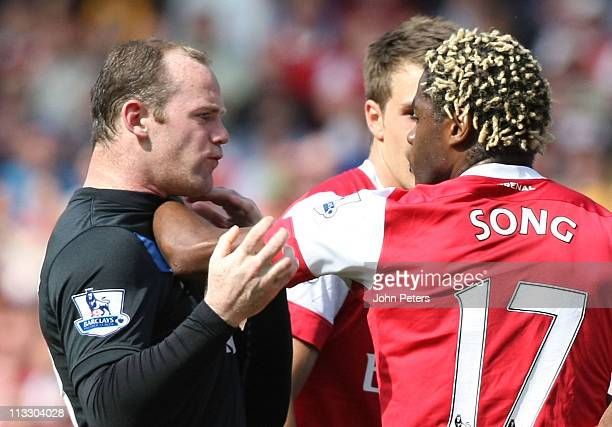 Wayne Rooney of Manchester United clashes with Alexandre Song of Arsenal during the Barclays Premier League match between Arsenal and Manchester...