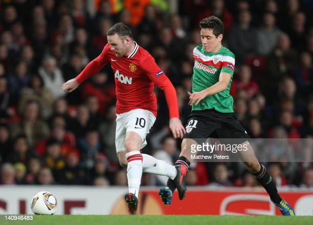 Wayne Rooney of Manchester United clashes with Ander Herrera of Athletic Club of Bilbao during the UEFA Europa League Round of 16 first leg match...