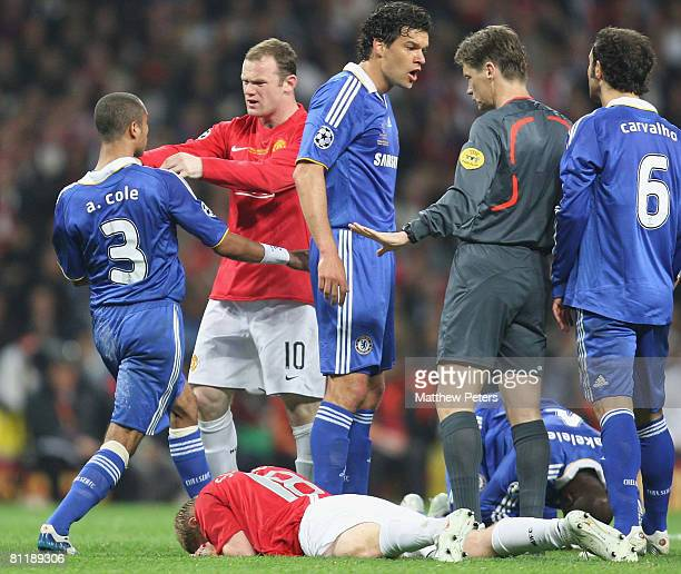 Wayne Rooney of Manchester United clashes with Ashley Cole of Chelsea during the UEFA Champions League Final match between Manchester United and...