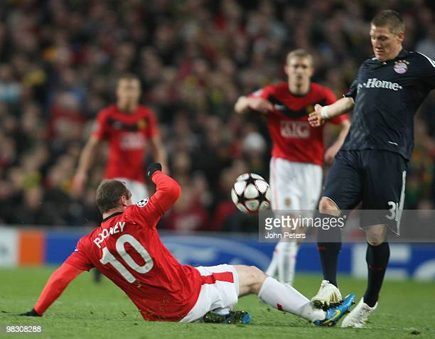 Wayne Rooney of Manchester United clashes with Bastian Schweinsteiger of Bayern Munich during the UEFA Champions League QuarterFinal Second Leg match...