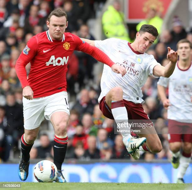 Wayne Rooney of Manchester United clashes with Ciaran Clark of Aston Villa during the Barclays Premier League match between Manchester United and...