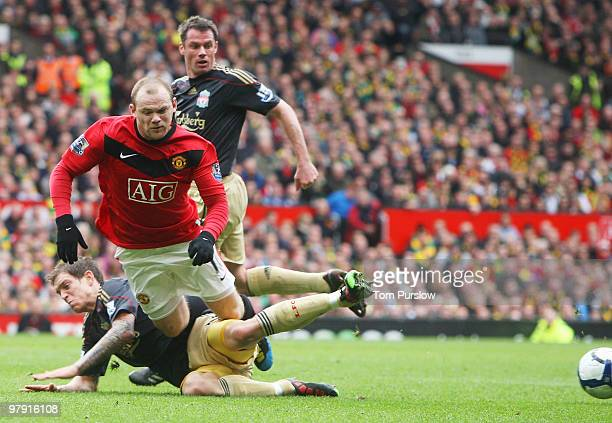 Wayne Rooney of Manchester United clashes with Daniel Agger of Liverpool during the FA Barclays Premier League match between Manchester United and...
