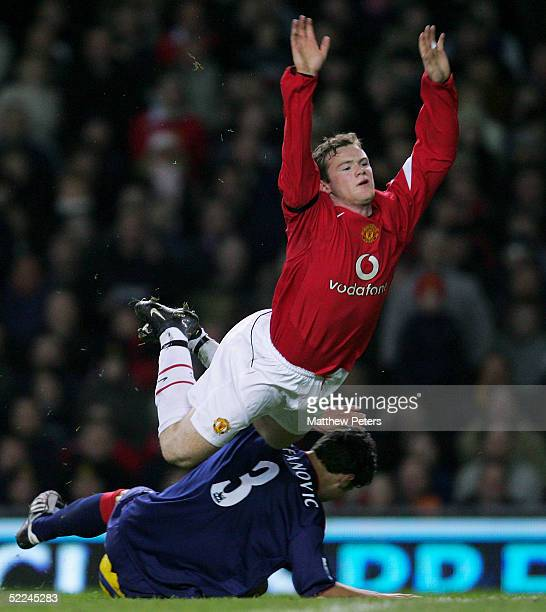 Wayne Rooney of Manchester United clashes with Dejan Stefanovic of Portsmouth during the Barclays Premiership match between Manchester United and...