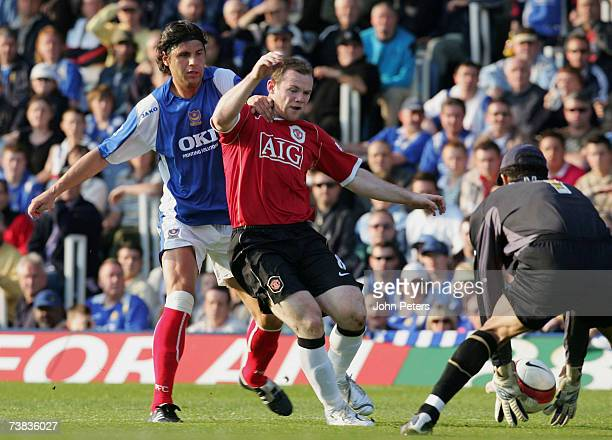 Wayne Rooney of Manchester United clashes with Dejan Stefanovic of Portsmouth during the Barclays Premiership match between Portsmouth and Manchester...