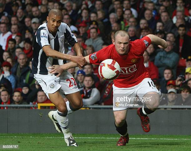 Wayne Rooney of Manchester United clashes with Gianni Zuiverloon of West Bromwich Albion during the Barclays Premier League match between Manchester...