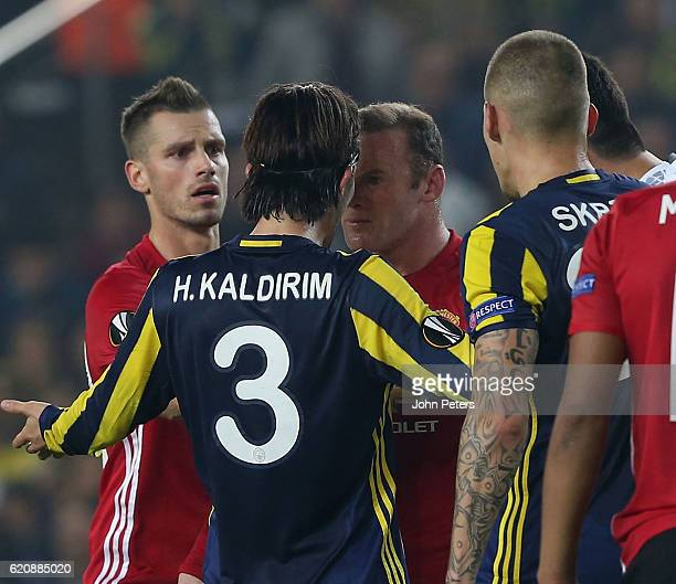 Wayne Rooney of Manchester United clashes with Hasan Ali Kaldirim of Fenerbahce during the UEFA Europa League match between Manchester United and...