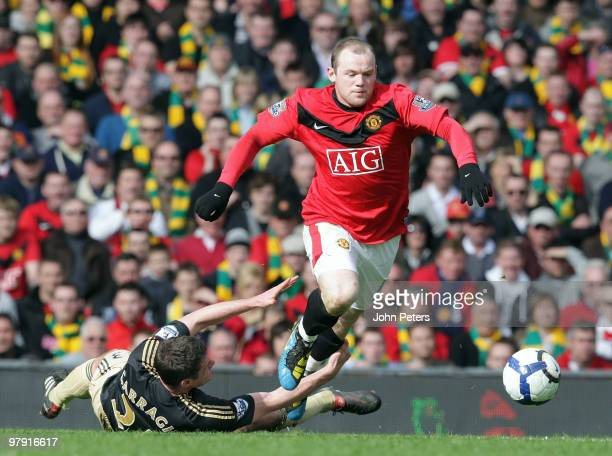Wayne Rooney of Manchester United clashes with Jamie Carragher of Liverpool during the FA Barclays Premier League match between Manchester United and...