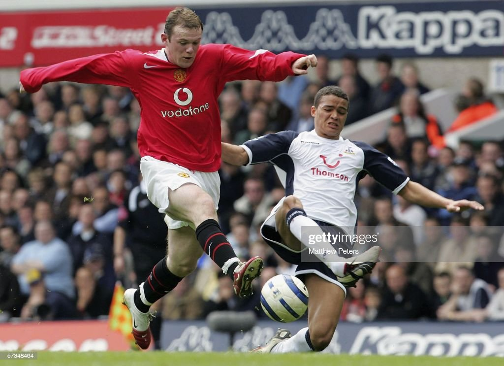 Wayne Rooney of Manchester United clashes with Jermaine Jenas of Tottenham Hotspur during the Barclays Premiership match between Tottenham Hotspur and Manchester United at White Hart Lane on April 17 2006 in London, England.