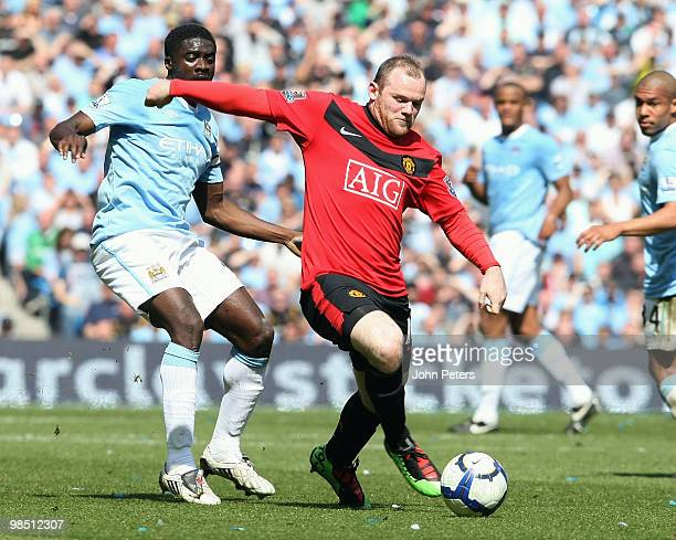 Wayne Rooney of Manchester United clashes with Kolo Toure of Manchester City during the Barclays Premier League match between Manchester City and...