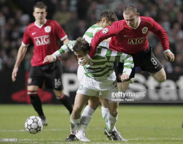 Wayne Rooney of Manchester United clashes with Lee Naylor of Celtic during the UEFA Champions League match between Celtic and Manchester United at...