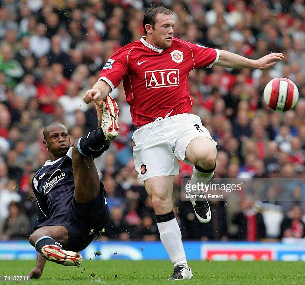 Wayne Rooney of Manchester United clashes with Luis Boa Morte of West Ham United during the Barclays Premiership match between Manchester United and...