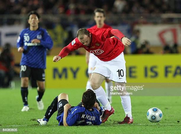 Wayne Rooney of Manchester United clashes with Michihiro Yasuda of Gamba Osaka during the FIFA World Club Cup Semi-Final match between Gamba Osaka...