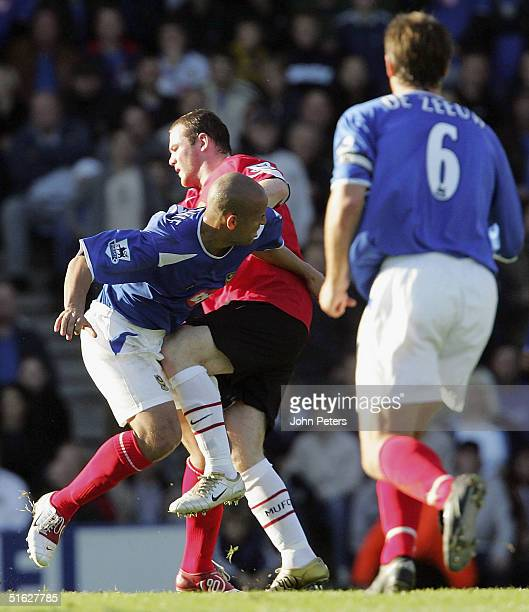 Wayne Rooney of Manchester United clashes with Nigel Quashie of Portsmouth during the Barclays Premiership match between Portsmouth and Manchester...