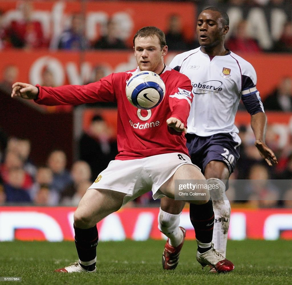 Wayne Rooney of Manchester United clashes with Nigel Reo-Coker of West Ham United during the Barclays Premiership match between Manchester United and West Ham United at Old Trafford on March 29 2006 in Manchester, England.