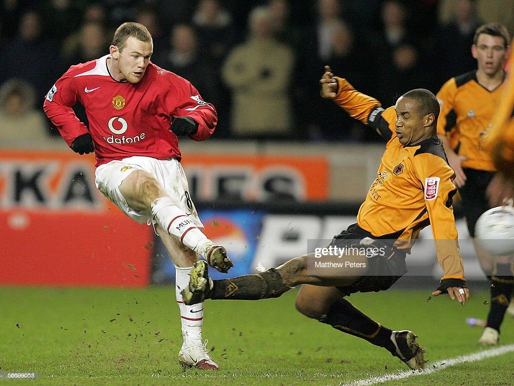 Wayne Rooney of Manchester United clashes with Paul Ince of Wolverhampton Wanderers during the FA Cup Fourth Round match between Wolverhampton Wanderers and Manchester United at Molineux on January 29 2006 in Wolverhampton, England.