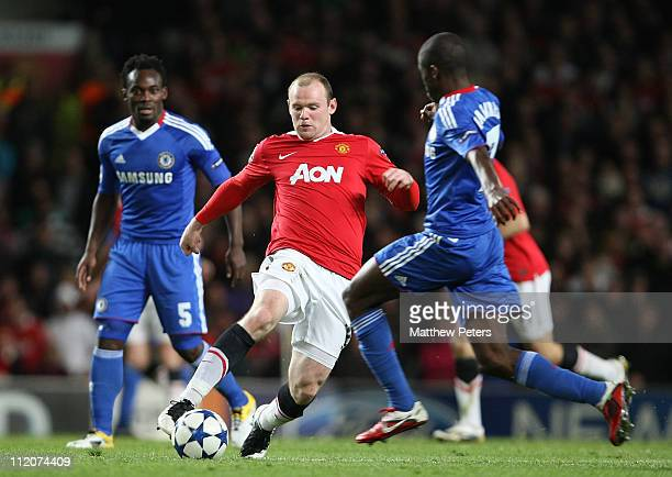 Wayne Rooney of Manchester United clashes with Ramires of Chelsea during the UEFA Champions League QuarterFinal second leg match between Manchester...
