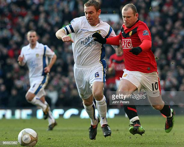 Wayne Rooney of Manchester United clashes with Richard Naylor of Leeds United during the FA Cup Sponsored by EOn Third Round match between Manchester...