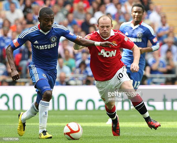Wayne Rooney of Manchester United clashes with Salomon Kalou of Chelsea during the FA Community Shield match between Chelsea and Manchester United at...