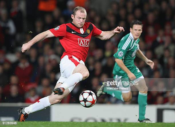 Wayne Rooney of Manchester United clashes with Sascha Riether of Wolfsburg during the UEFA Champions League match between Manchester United and...