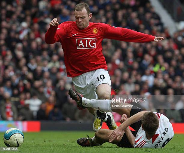 Wayne Rooney of Manchester United clashes with Steven Gerrard of Liverpool during the Barclays FA Premier League match between Manchester United and...