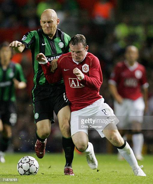 Wayne Rooney of Manchester United clashes with Thomas Gravesen of Celtic during the UEFA Champions League match between Manchester United and Celtic...