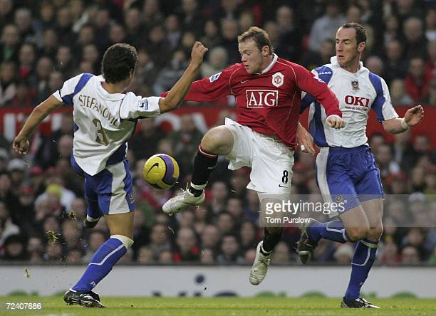 Wayne Rooney of Manchester United clasheswith Dejan Stefanovic of Portsmouth during the Barclays Premiership match between Manchester United and...