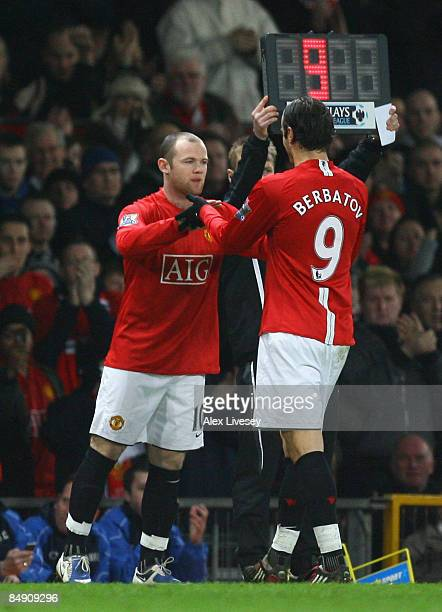 Wayne Rooney of Manchester United comes on as a substitute for Dimitar Berbatov during the Barclays Premier League match between Manchester United...