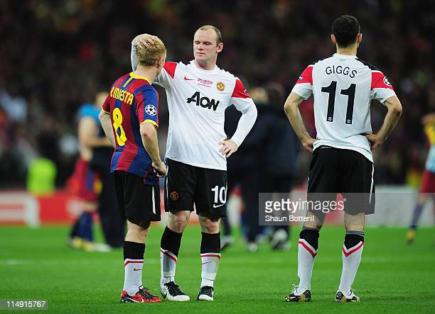 Wayne Rooney of Manchester United comforts teammate Paul Scholes after the UEFA Champions League final between FC Barcelona and Manchester United FC...