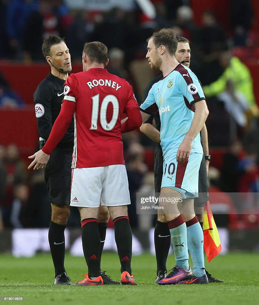 Wayne Rooney of Manchester United complains to referee Mark Clattenburg after the Premier League match between Manchester United and Burnley at Old Trafford on October 29, 2016 in Manchester, England.