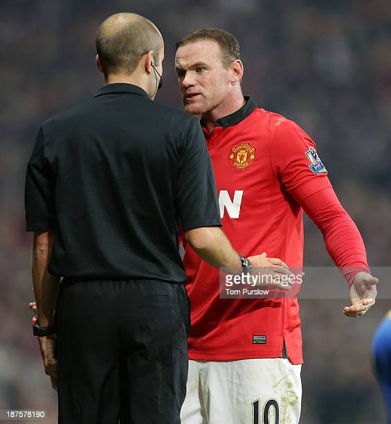 Wayne Rooney of Manchester United complains to referee Michael Oliver during the Barclays Premier League Match between Manchester United and Arsenal...