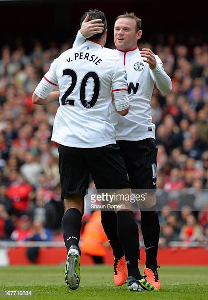 Wayne Rooney of Manchester United congratulates Robin van Persie of Manchester United after he scored from the penalty spot to make it 11 during the...