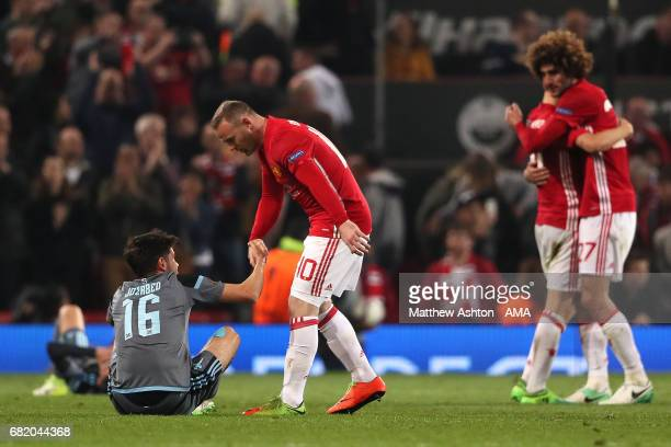 Wayne Rooney of Manchester United consoles Jozabed of Celta Vigo at the end of the UEFA Europa League semi final second leg match between Manchester...