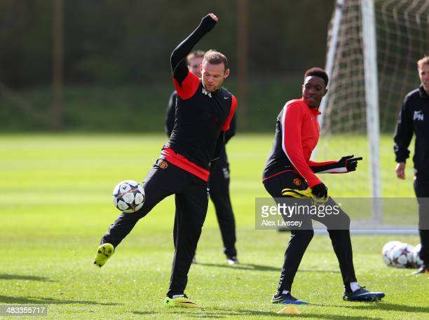 Wayne Rooney of Manchester United controls the ball as Danny Welbeck looks on during a training session at Aon Training Complex on April 8 2014 in...