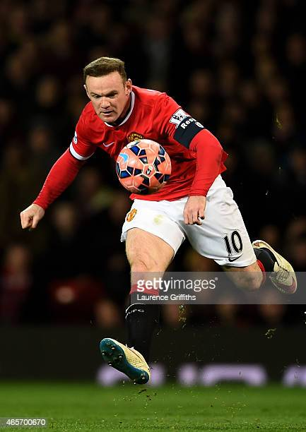 Wayne Rooney of Manchester United controls the ball during the FA Cup Quarter Final match between Manchester United and Arsenal at Old Trafford on...