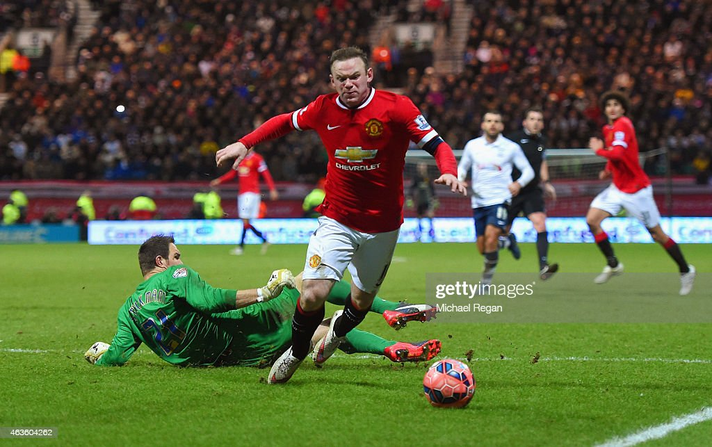 Wayne Rooney of Manchester United draws a foul from Thorsten Stuckmann of Preston North End to win a penalty during the FA Cup Fifth round match between Preston North End and Manchester United at Deepdale on February 16, 2015 in Preston, England
