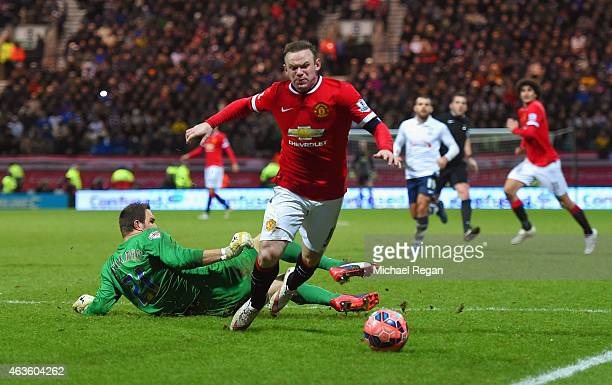 Wayne Rooney of Manchester United draws a foul from Thorsten Stuckmann of Preston North End to win a penalty during the FA Cup Fifth round match...