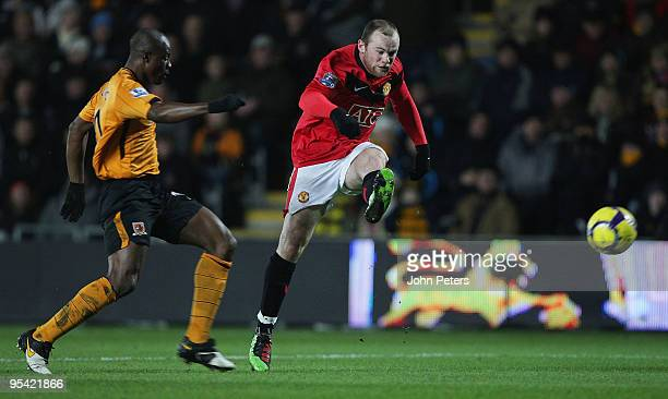 Wayne Rooney of Manchester United fires a shot past George Boateng of Hull City during the Barclays Premier League match between Hull City and...