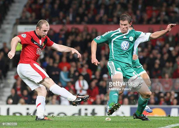 Wayne Rooney of Manchester United has a shot during the UEFA Champions League match between Manchester United and Wolfsburg at Old Trafford on...