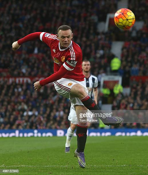 Wayne Rooney of Manchester United has a shot on goal during the Barclays Premier League match between Manchester United and West Bromwich Albion at...