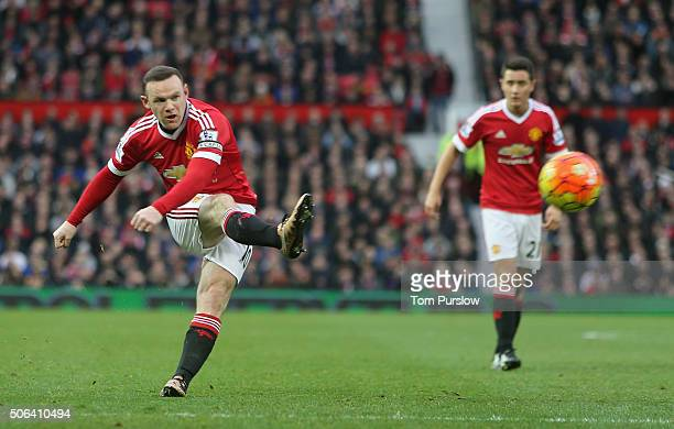 Wayne Rooney of Manchester United has a shot on goal during the Barclays Premier League match between Manchester United and Jose Fonte at Old...