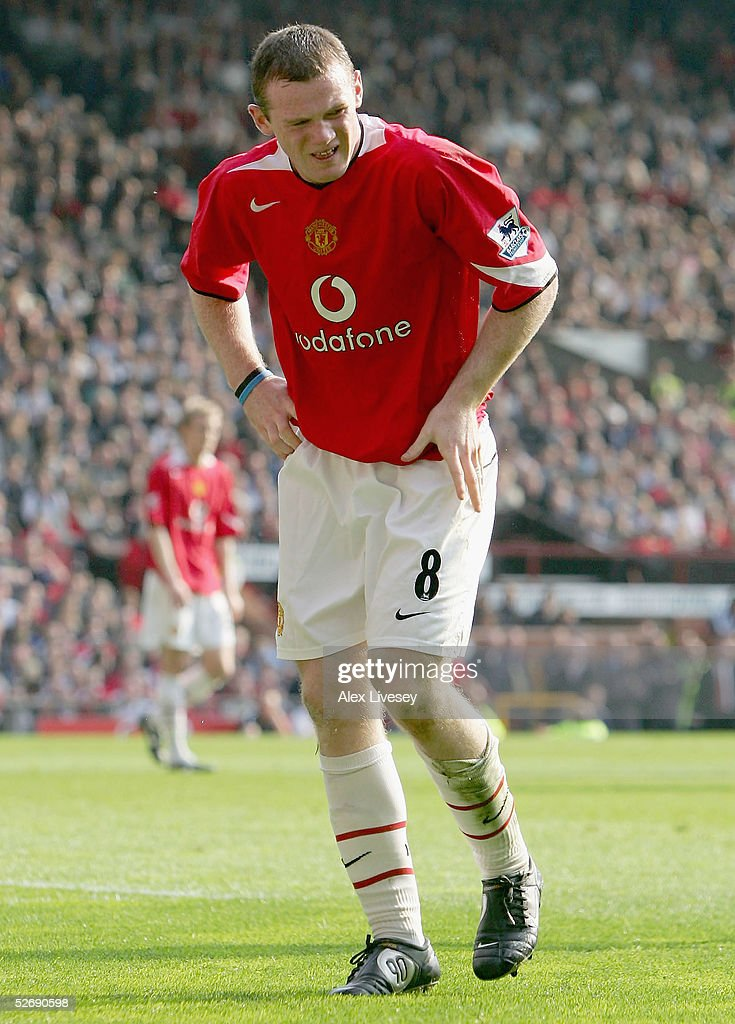 Wayne Rooney of Manchester United hobbles off injured during the first half of the Barclays Premiership match between Manchester United and Newcastle United at Old Trafford on April 24, 2005 in Manchester, England.