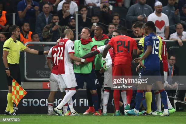 Wayne Rooney of Manchester United holds back Hakim Ziyech of Ajax during the UEFA Europa League Final between Ajax and Manchester United at Friends...