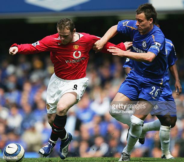 Wayne Rooney of Manchester United holds off the challenge of John Terry of Chelsea during the Barclays Premiership match between Chelsea and...