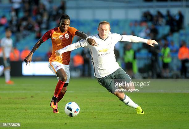 Wayne Rooney of Manchester United in action against Bruma of Galatasaray during the Friendly match between Galatasaray and Manchester United at...