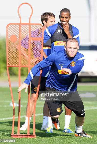 Wayne Rooney of Manchester United in action during a first team training session at Carrington Training Ground on September 30, 2011 in Manchester,...