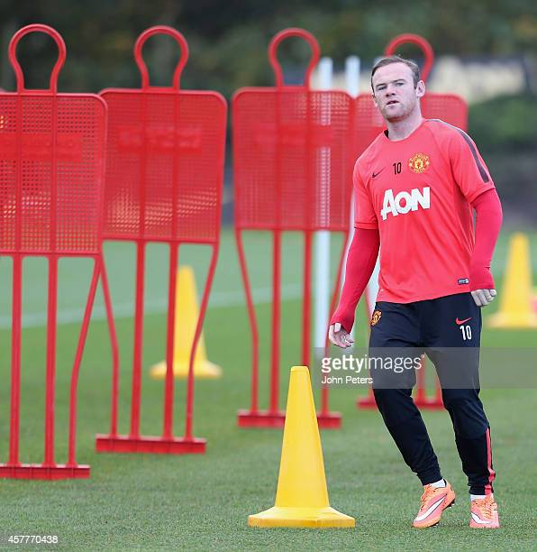 Wayne Rooney of Manchester United in action during a first team training session at Aon Training Complex on October 24, 2014 in Manchester, England.