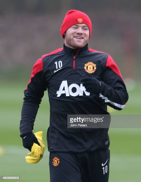Wayne Rooney of Manchester United in action during a first team training session at Aon Training Complex on January 30 2014 in Manchester England