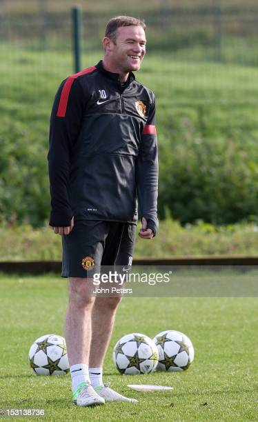 Wayne Rooney of Manchester United in action during a first team training session ahead of their UEFA Champions League match against Cluj at...