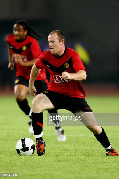 Wayne Rooney of Manchester United in action during a preseason friendly match between Hangzhou Greentown and Manchester United as part of the club's...