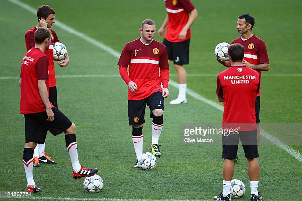 Wayne Rooney of Manchester United in action during a training session ahead of the UEFA Champions League Group C match between SL Benfica and...